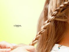 Create a soft pretty braid with L'Oréal Paris Extraordinary Oil  1) Apply a few drops on damp hair, start braiding from one side of your head, creating 3 sections. 2) Braid normally, crossing the bottom section of your braid over the center, then the top section over that. 3) Add a little more hair to the top section before crossing it over, like a french braid. 4) Cross the bottom section over it. Like this tip? Pin it!:)