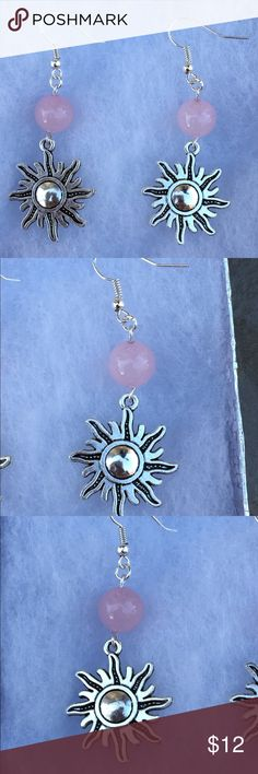 Pink Rose Quartz Silver Sun Earrings These beautiful earrings are made with natural rose quartz. They feature silver tone sun charms and sterling silver plated hooks.   All PeaceFrog jewelry items are handmade by me! Take a look through my boutique for more unique creations. PeaceFrog Jewelry Earrings
