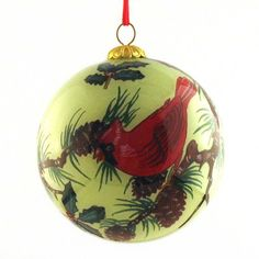 $13.99-$19.99 Ornament, Two Cardinals - CO129 - Bright red cardinals are easily identified by even casual bird watchers, and are often seen frequenting backyards and bird feeders. When foraging elsewhere the birds eat insects, seeds, grain, fruit, and sap. Each hand-blown glass ornament is hand painted in reverse on the inside of the glass. Choosing from a selection of miniature curved shaft bru ...