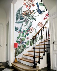 Large scale floral/ foliage wallpaper up a curved staircase. GORGEOUS! 2018's Most-Liked Entryway