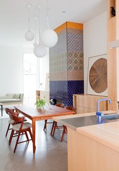 These mix-and-match pendant lights from Luminosa are a playful addition to this Johnson McLeod-designed vacation home. This Seppo Koho light fixture brings a beachy flare to this oceanside, Kelly...