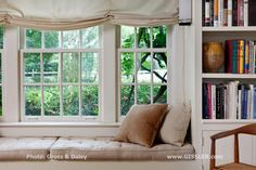 These window seat cushions were made by Jonas for this now 25+ year old project. The cushions are densely filled with horse hair with soft tufting and upholstered with linen. The golden pillow is covered in Gretchen Bellinger 'Applause' - a luxurious cotton velvet. My clients are very interested in modern design so the understated wall sconces designed by Andree Putman circa 1980, and the classic oak and cane by Hans Wegner. www.GISSLER.com
