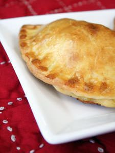 This is a classic piroshki recipe. You make these in three steps: make the dough, cook the filling, and then assemble the piroshki. It's easiest to do with a dough press but you can build it manually. If so, be sure to seal the edges well with the tines of a fork.