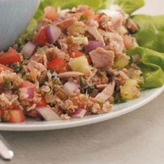 Tuna Tabbouleh Salad Recipe -Have the deli at home with Natalie Bremson's spin on classic tuna salad. The Plantation, Florida cook uses the bright flavors of mint and lemon to enhance the tuna, leaving you feeling refreshed and satisfied.