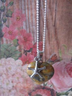 Just in!Charmed Hearts Cr... Check it out here- http://www.nc-crafts-and-gardens.net/products/charmed-hearts-crazy-lace-agate-with-starfish?utm_campaign=social_autopilot&utm_source=pin&utm_medium=pin
