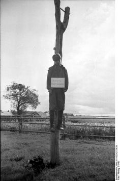 """The sign reads: """"I am a partisan."""" Southern Russia, spring 1942."""