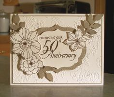 This beautiful handmade card will help you celebrate the happy couple that has been blessed with 50 years of marriage! The card measures 6 1/2 x 5