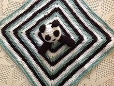 """I fell in love with the Baby Panda Outfit I found on here and it made me decide to add pandas to my baby """"theme"""" when we have one so I made this Panda Lovey. It can easily be altered into a brown teddy (or whatever color bear) I think it's too cute not to make!"""