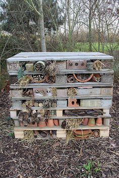 Back garden Bug Hotel out of pallets, brick post and garden bric-a-brac
