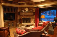 Large, rustic stone fireplace in a gorgeous Tuscan style home with rustic flair.