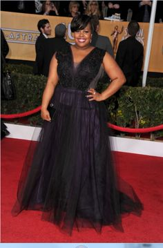 Amber Riley of Glee wearing a Ritani for Forevermark diamond solitaire ring at the 2013 SAG Awards