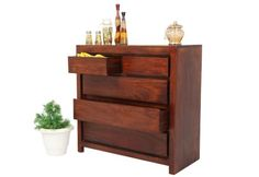 Buy #Rudolph #Chest #Of #5 #Drawers with Teak Finish online at Wooden Street. Choose from wide range of #wooden #bedroom #cabinets available in variety of designs, sizes and finishes. Visit : https://www.woodenstreet.com/bedroom-cabinets in #Ahmedabad #Bangalore #Chandigarh #Chennai