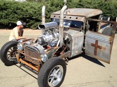 Josey Gula, 30, of Chico looks at an award-winning rat rod at Kool April Nites on Saturday. He remarked that the car was creative. Around 1,800 cars participated in Saturday's display at the Redding Civic Auditorium.