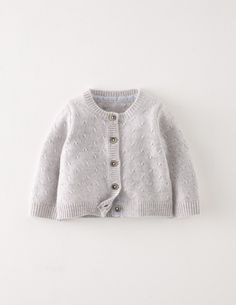 Keep little lovelies cosy with our sweet cardigan. It's just right for layering over dresses or tees when the weather's still a bit chilly. Made from 100% cashmere, it's kind on the skin and you can pop it in the wash after the inevitable dribbles. A perfect choice for the most special gift ever.