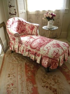 ...vintage French chaise lounge...slipcovered in a stunning raspberry/mint toile...original brown velvet upholstery underneath...wonderful piece for a bedroom, sunroom, living room...in good condition...26 inches wide...56 inches long...31 inches tallPlease contact The Painted Chateau for shipping charges.