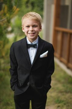 Classic ring bearer outfit idea - black suit + black bow tie for ring bearer {Tony Gambino Photography}