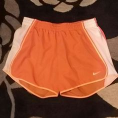 Sport Short Nike Sport Short Nike, body:100%polyester, lining:100%polyester, exclusive of decoration, color orange and white Nike Shorts Skorts