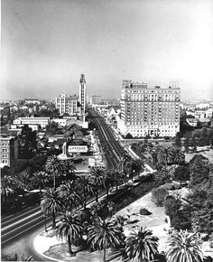 This 1930s photo shows us Wilshire Blvd as it angles to the left at Lafayette Park. When Los Angeles was originally laid, the founders followed the Spanish way of laying a street grid—orienting 45 degrees off the cardinal directions. By the time LA's spread reached where Hoover Street now, the city adopted the American way of laying out streets, which is to orient them along the north-south and east-west points of the compass.