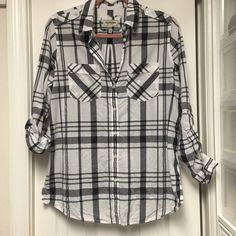 Express boyfriend black n white plaid button shirt Worn twice. Comfortable and adjustable sleeves. Smoke free home Express Tops Button Down Shirts