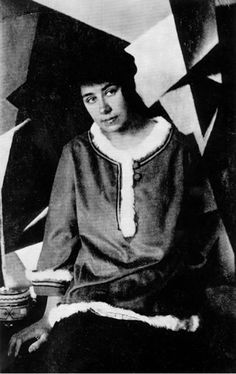 Liubov Popova in her studio, early 1919 She sits in front of a Painterly Architectonic Photograph taken by Aleksandr Rodchenko In L. S. POPOVA 1889-1924