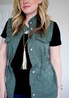 vest, black v neck, silver tassel necklace