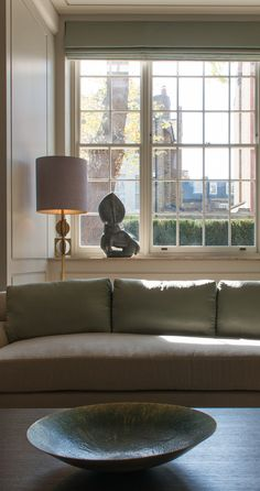 Strong sculptural shapes for the artwork and tablelamp are juxtaposed with soft tones in green, lavender, ivory and cream. Sitting room, Bedford Gardens, London.