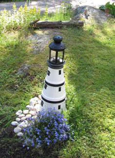 Landscaping, a must have layout ref 4324883692 for one superb yard. Lake Garden, Lawn And Garden, Garden Art, Garden Design, Garden Lighthouse, Clay Pot Lighthouse, Clay Pot Projects, Clay Pot Crafts, Flower Pot Crafts