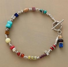 "Sterling beads and charms mingle with colorful gems, including coral, turquoise, garnet, carnelian, lapis, tigereye, jasper, rhodonite and peridot. Sterling silver toggle clasp. Handcrafted in USA exclusively for Sundance. 7-1/2""L."