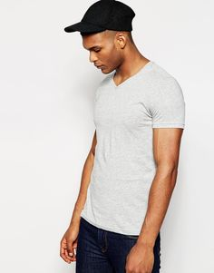 """T-shirt by United Colors of Benetton Soft-touch, cotton jersey V-neck Regular fit - true to size Machine wash 100% Cotton Our model wears a size Medium and is 188cm/6'2"""" tall"""