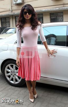 Pretty in pink: We caught a good look at Bollywood actress Priyanka Chopra at an event to launch the mobile application of UNICEF in Mumbai.     Priyanka was a sight for sore eyes in a pink and white flared Emporio Armani dress