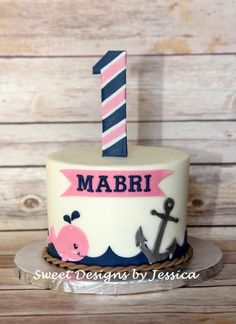 Mabri's smash cake, nautical girl cake, anchor cake replace whale with lifering, number one with second tier, rope around second tier use waves along the bottom Nautical Birthday Cakes, Anchor Birthday, 1st Birthday Cakes, Nautical Party, Baby First Birthday, Girl Birthday, First Birthday Parties, Birthday Ideas, Nautical Cake Smash