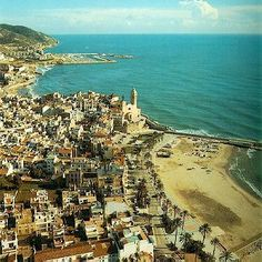 """Sitges is often referred to as the """"Key West"""" of Spain. This relaxed beach town is just a 30 minute drive from the bustling city of Barcelona and has a plethora of shops, cafes, beautiful beaches, bars and lovely accommodations."""