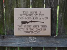 This House is Protected by the Good Lord and a Gun Yard Sign