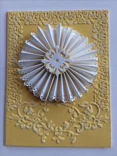 I made this with Sizzix ornament embossing folder& Suzzix thinlit 658954. I edge punched the rosette with Martha Stewart punch.