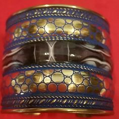 "NWOT Brass cuff from Palestine Purchased in Palestine.  Hand made. Photos speak for it. 1"" opening. Main colors are brass, blue and black. Happy Poshing. Jewelry Bracelets"