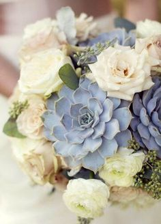 Simple succulent bouquet , roses in cream and Sahara , mixed with a few ranunculus - the large blue tone succulents really add impact