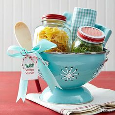 For the friend who's got a busy weeknight schedule, give the gift of a worry-free dinner. Fill one jar with pasta and one with pesto or a favorite sauce. Embellish jar lids with festive ribbon. Add white yarn to colander holes for snowflake look. Finish with printable tag and a ribbon bow.  /