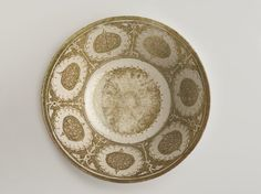 Bowl Medium: Ceramic; fritware, painted in copper luster on a white slip ground under a transparent glaze Dates: early 13th century