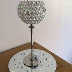 Wedding event party hire faceted globe ball tealights holders sparkling Cambridgeshire based  https://www.facebook.com/pages/TLC-Candy-Cart-Hire/1567572446801237 Wedding centrepiece ,mirror plates  Please look at our many other hire items £8 hire fee each