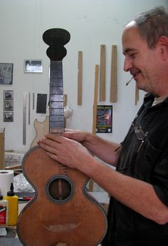 French luthier Dominique Bouges with a vintage guitar