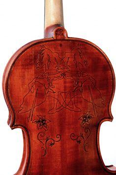 Violin with inlaid horses by Latvian violin maker Ingars Rancevics