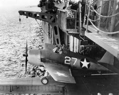 Grumman F6F-3 Hellcat squadron VF-1 is launched from the side of the hangar catapult of the aircraft carrier USS Yorktown (CV-10) June 3, 1943: USS Yorktown (CV-10) is visible on lateral catapult starboard bow. Note that this unit will be equipped with a skew bridge later
