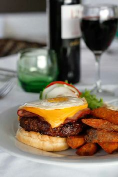 Chef's burger with garlic mayonnaise, B.B.Q sauce, ham, sliced cheese, slow cooked onion and fried egg. #wheretoeatinAntigua #BayHouseRestaurant