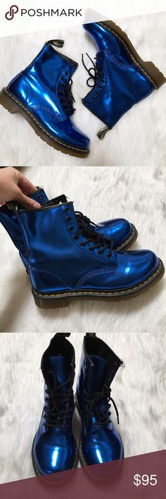 Doc Marten's 1460 Shiny Blue Patent Leather Boots Classic Doc Martens with a fun shiny color that will make you standout for sure. Built to last. AirWair sole, which is oil and fat resistant, with good abrasion and slip resistance. They appear to be in excellent used condition with almost no wear on the bottom and a few loose threads on the inside. Dr. Martens Shoes Combat & Moto Boots
