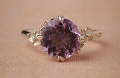 Love an amethyst ring for a non-traditional engagement ring.