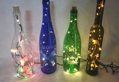 Suzy's Treasure Chest Wine Bottle Lights made from recylced wine bottles. These are done with LED mini lights to maintain a safe temperature inside the bottle for long term usage with engery saving bulbs. Recycled Wine Bottles, Lighted Wine Bottles, Bottle Lights, Online Gift Shop, Wine Time, Treasure Chest, Suzy, Beauty Care, Bulbs