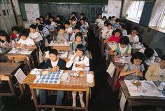 Schoolchildren eating at their desks. Japan