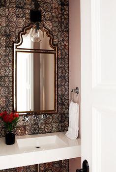 Antique mirror in tiled bathroom