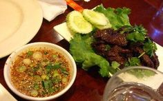 Tiger Cry: Tender beef charbroiled to perfection, served with homemade hot sauce at Opart Thai.  4658 N Western Ave.