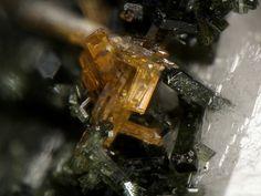 Labuntsovite-Mn, Na4K4(Ba,K)(Mn,Fe)1+x(Ti,Nb)8[Si4O12]4(O,OH)8•n(H2O), n=10-12, Poudrette quarry (Demix quarry; Uni-Mix quarry; Desourdy quarry), Mont Saint-Hilaire, Rouville Co., Québec, Canada. Fov 2 mm. Copyright: Stephan Wolfsried
